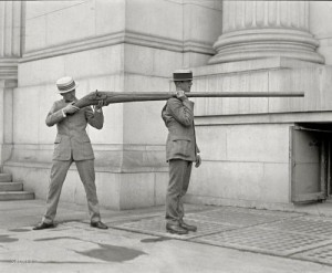 Two guys firing a punt gun on land